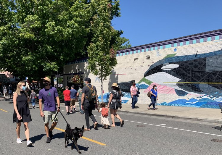 Walkable Mainstreet closes the downtown streets of Edmonds for walking and shopping. The Orca mural in the background. Photograph by Ellen Hiatt.